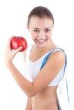 Junge sportliche Frau mit rotem Apfel Stockfotos