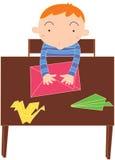 Junge am Tisch Stockbilder
