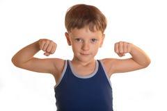Junge tut körperliche Bewegungen Lizenzfreie Stockbilder