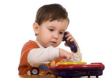 Junge u. Telefon Lizenzfreies Stockfoto
