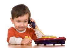 Junge u. Telefon Lizenzfreies Stockbild