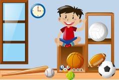 Junge und Bälle im Raum Stockbild