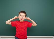 Junge und die Schulbehörde Stockbild