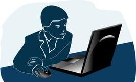 Junge und ein Laptop Lizenzfreie Stockbilder
