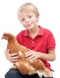 Junge und eine Henne. lizenzfreie stockbilder