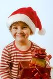 Junge und Geschenke Stockfoto