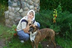 Junge und Hund Stockfotos