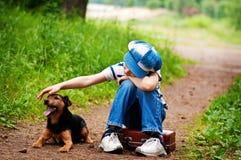 Junge und Hund Lizenzfreie Stockfotos