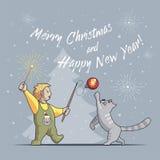 Junge und Katze spielen und feiern Weihnachten und neues Jahr lizenzfreie stockfotos