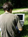 Junge und Laptop stockbilder