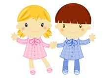 Junge und Mädchen, die Primärschule-Kinderschürze tragen Lizenzfreies Stockfoto