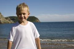 Junge und Meer Stockfotos