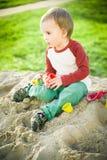 Junge und Sand Stockbilder