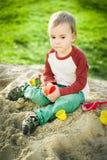 Junge und Sand Stockfotos