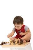 Junge und Schach Lizenzfreie Stockfotos