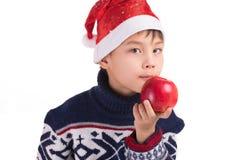 Junge und sein Apple Lizenzfreies Stockbild