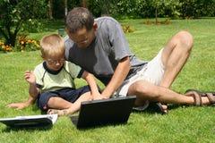 Junge und seines Vaters Lizenzfreies Stockbild