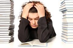Junge unglücklich und viele Bücher Lizenzfreies Stockbild