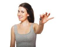 Junge weibliche Holdingtasten Stockbild
