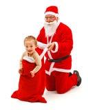 Junge Weihnachtsmanns im Beutel lizenzfreies stockfoto