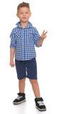 Junge zeigt seine Hände Lizenzfreies Stockfoto