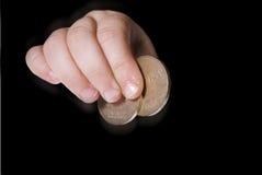 Jungen übergeben mit Geld Stockfotos