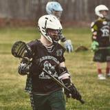 Jungen Lacrosse lizenzfreies stockbild