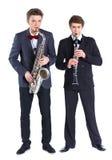 Jungen mit Saxophon und Klarinette Lizenzfreies Stockbild