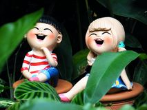 Jungen-und Mädchen-Puppen Stockfotos