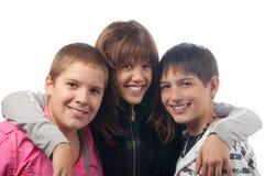 Jungen und Mädchenlächeln Stockbild