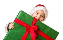 Jungen- und Weihnachtsgeschenk Stockbild