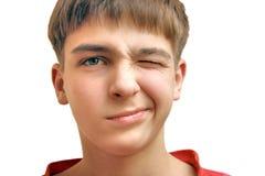 Jungenblinzeln Stockfotos