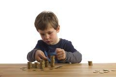 Jungengebäudekontrolltürme aus Geld heraus Lizenzfreies Stockbild