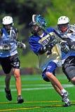 Jungenjugend Lacrosseseitentrieb stockfotografie