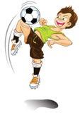 Jungenkarikatur, die Fußball spielt Stockfotografie