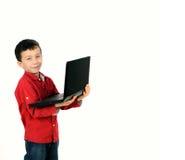 Jungenkind mit Notizbuch Stockfoto