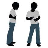Jungenschattenbild in der glücklichen Gesprächs-Haltung lizenzfreie abbildung