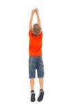 Jungenspringen der hinteren Ansicht Stockfoto