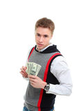 Junger überzeugter Mann hält Dollar an Lizenzfreie Stockbilder