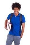 Junger Afroamerikanerstudent, der Bücher - afrikanische Leute hält Lizenzfreies Stockbild