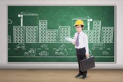 Junger Architekt mit Bild von Gebäuden Lizenzfreies Stockbild