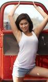 Junger asiatischer Schönheits-Rot-LKW Stockbild