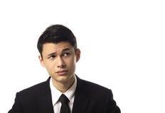 Junger asiatischer Unternehmensmann, der recht schaut Lizenzfreies Stockfoto