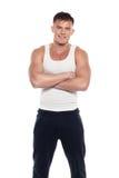 Junger athletischer Mann im weißen Hemd Stockbild