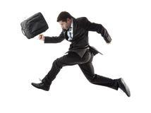 Junger attraktiver Geschäftsmann, der spät läuft, um im Druck zu arbeiten Stockbild