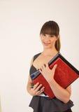 Junger attraktiver weiblicher Büroangestellter Stockfotografie