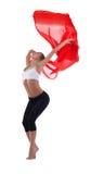 Junger blonder Frauentanz mit rotem Flugwesengewebe Lizenzfreie Stockbilder
