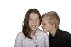 Junger blonder Junge stiehlt einen Kuss Lizenzfreies Stockfoto