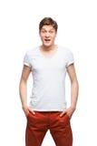 Junger blonder Mann auf Weiß Lizenzfreie Stockbilder