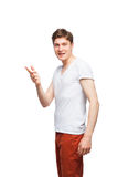 Junger blonder Mann lokalisiert auf Weiß Stockfotografie